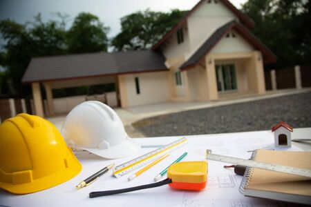 Desk of Architectural working project in construction site,With drawing equipment concept.