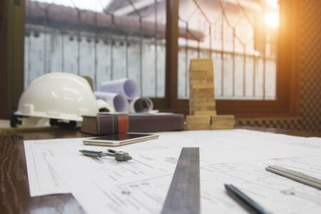 Architect desk ,Business,engineering concept,construction site, soft focus, vintage tone, working with blueprints in the office