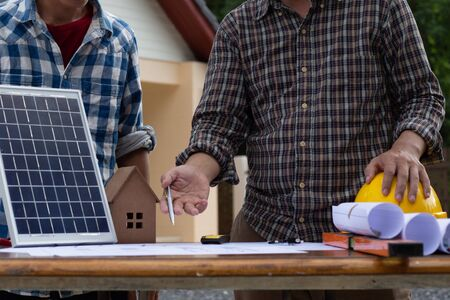 Team Engineers are writing solar panel for home construction designs to bring them to prospective customers.concept Standard-Bild - 134398512
