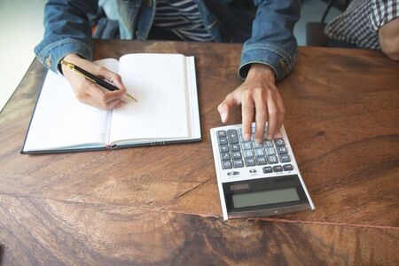 businessman are using calculators to calculate income for taxation.concept
