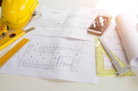 Architectural Office desk background construction project ideas concept, With drawing equipment