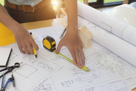 Engineer man and Architect drawings blueprint  at Construction Site.Home Project to Offer Management Zdjęcie Seryjne