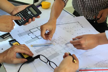 Team Engineers are writing solar panel for home construction designs to bring them to prospective customers.concept