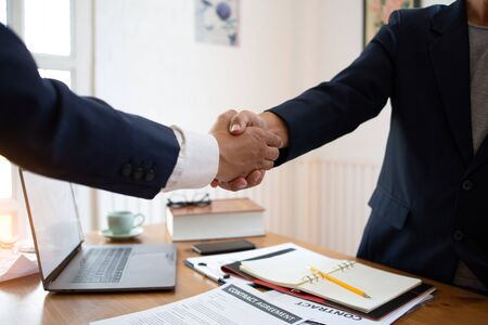 The lawyer shaking hand agreement for consult preparing the phrase to be law for people who come to listen to counseling to receive social justice. concept of business