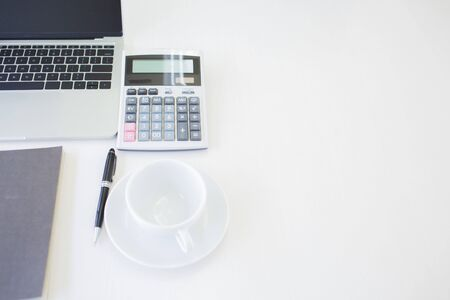 Accounting equipment is placed on the desk in the house to reduce meeting people according to work-at-home measures.