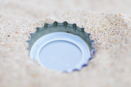 bottle with cap: Bottle cap on the beach