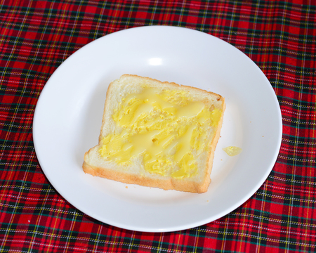 spreaded: slices of wheaten bread spreaded with butter Stock Photo