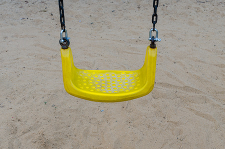 play the old park: yellow chain swings on playground