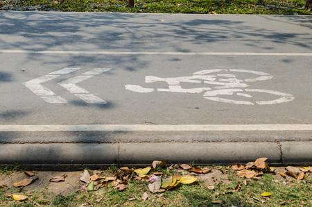 road bike: Bicycle road sign and bike rider Stock Photo