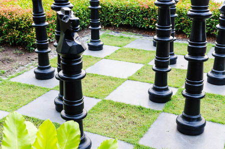 simulate: simulate,Large chess game on ground in the park