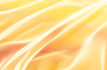 Closeup of abstract white mesh on yellow background