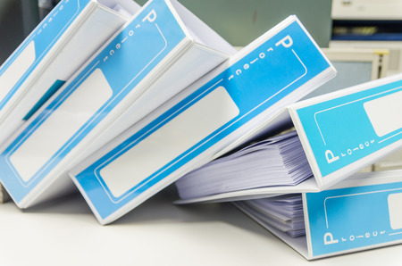 group  accountant: pile of document binder stacked on desk
