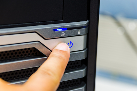 computer button: concept love earth ,  finger is pushing the power button of computer