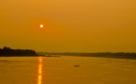 folkways: Fantastic landscape, fisherman Fishing at Mekong River on sunset background, Folkways of the Mekong River at nongkhai in thailand