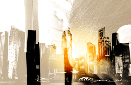 Double exposure picture, Hand In Jail, concept of life imprisonment with city landscape background Stock Photo