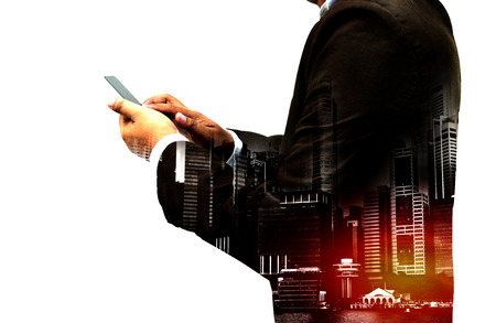 Double exposure - businessman using smartphone with city overlay isolated on white background