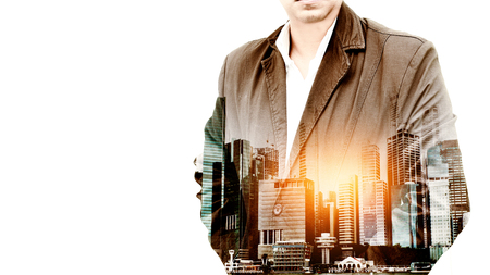 technology transaction: Portrait of a confident bearded businessman standing with his hands in pockets overlay city landscape background  . Double exposure. isolated on white background