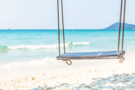 close up rope swing on white sand beach for tourist relax.  Summer holiday vacation background. copyspace Stock fotó