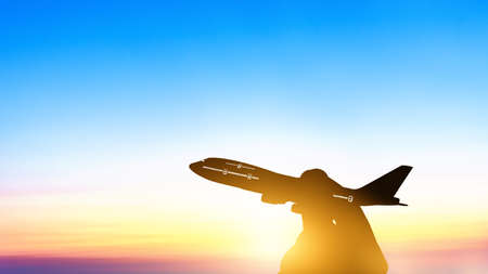 Silhouette of young asian holding miniature toy airplane flying on cloud blue sky at sunset background. Travel and trip at summer by airplane with copy space Stockfoto
