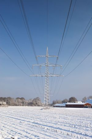 Power line with snow and blue sky Stock Photo