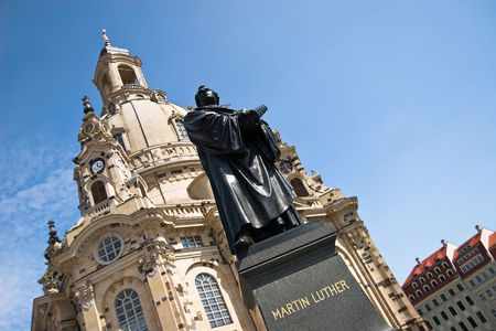 Statue of Martin Luther in Front of the famous reconstructed Church Frauenkirche in Dresden. Church Of Our Lady Stock Photo