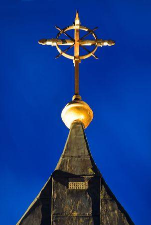 Church cross glowing in blue moonlight  photo