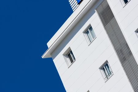 White art deco hotel in spain with clear blue sky  Stock Photo