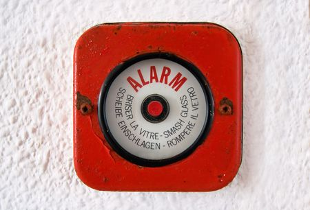 forewarning: Old fire Alarm. In case of a fire break the glass and set the alarm.