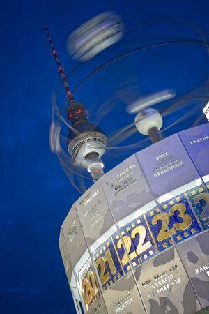 Alexanderplatz world clock and television tower at night, berlin, germany