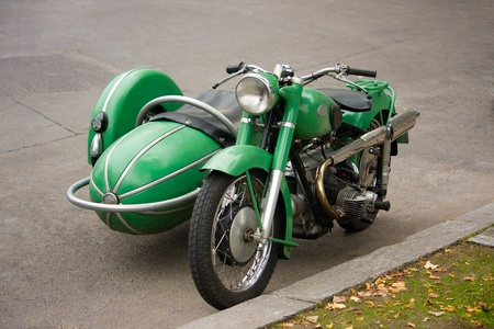 Old fashioned motorcycle with sidecar parked in the street  photo