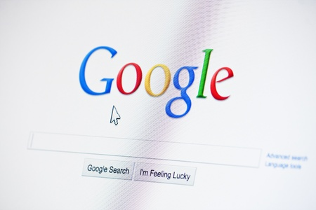 Muenster, Germany - March 15, 2011: Monitor display shows www.google.com site. Google is the biggest search engine website of the world, owned by Google, Inc.