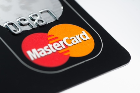 mastercard: Muenster, Germany - April 9, 2011: A close up macro shot of a Mastercard credit card. Mastercard is one of the biggest credit card companies in the world.  Editorial