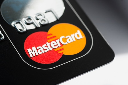 Muenster, Germany - April 9, 2011: A close up macro shot of a Mastercard credit card. Mastercard is one of the biggest credit card companies in the world.  Editorial
