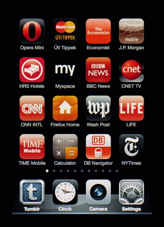 myspace: Muenster, Germany, April 16, 2011: Image of the iphone touch screen. Display shows a collection of useful apps with red color scheme. Editorial