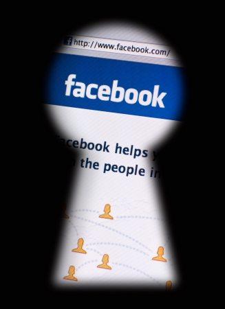Muenster, Germany - May 7, 2011: facebook.com website seen through a blurred keyhole. Photography concept of data privacy issues. Facebook is the biggest social networking website of the world, owned by Facebook, Inc.  Stock Photo - 9475437