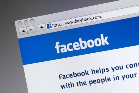 Muenster, Germany - May 7, 2011: facebook.com website on computer screen. Facebook is the biggest social networking website of the world, owned by Facebook, Inc.
