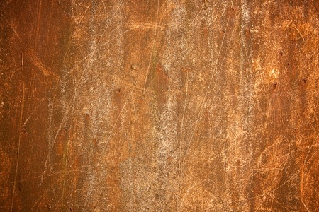 eroded: rusty metal background with scratched surface.