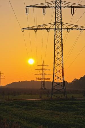 Power Line with illuminating sunset Stock Photo