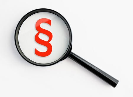 paragraph sign under a magnifying glass, with isolated background Stock Photo