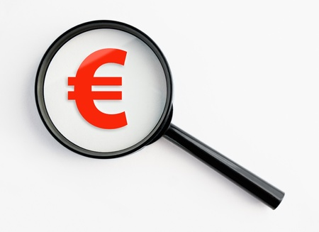 euro symbol under a magnifying glass, with isolated background Stock Photo