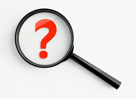 question mark under a magnifying glass, with isolated background photo