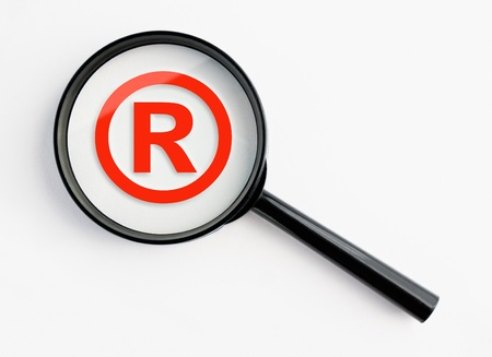 registered trademark under a magnifying glass, with isolated background Stock Photo - 11142492