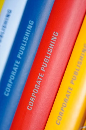 Colorful collection of annual reports in a row