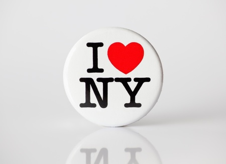 advertise with us: Muenster, Germany - January 28, 2012: Picture shows the famous i love ny logo from the city of new york, printed on a badge.