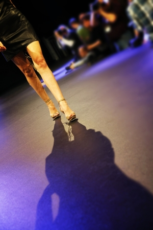 Woman walking down the catwalk at the fashion show