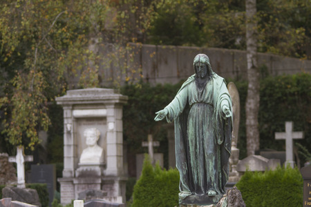 Christ statue on a grave stone