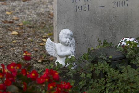 christian halloween: Angel on the grave stone