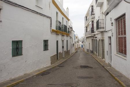 Facades of spanish houses in the white city of Conil de la Frontera on the Costa del luz