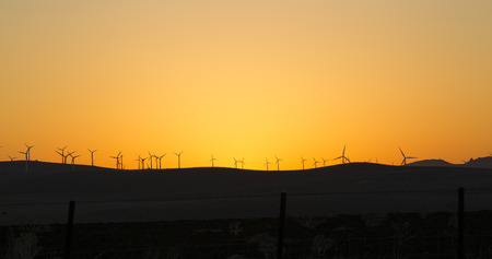 Sunset in Andalucia behind a variety of wind turbines