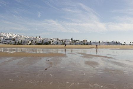 View from the beach to the Spanish city of Conil de la frontera in Andalucia